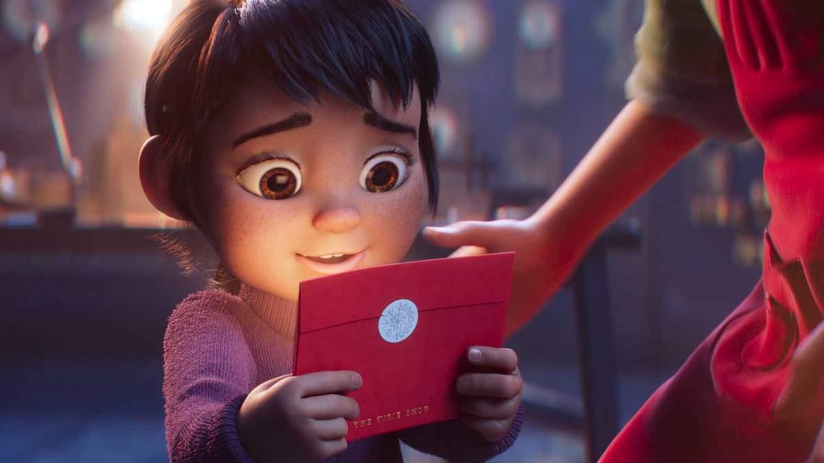 Дівчинка з різдвяного ролику, який вчить цінувати сім'ю