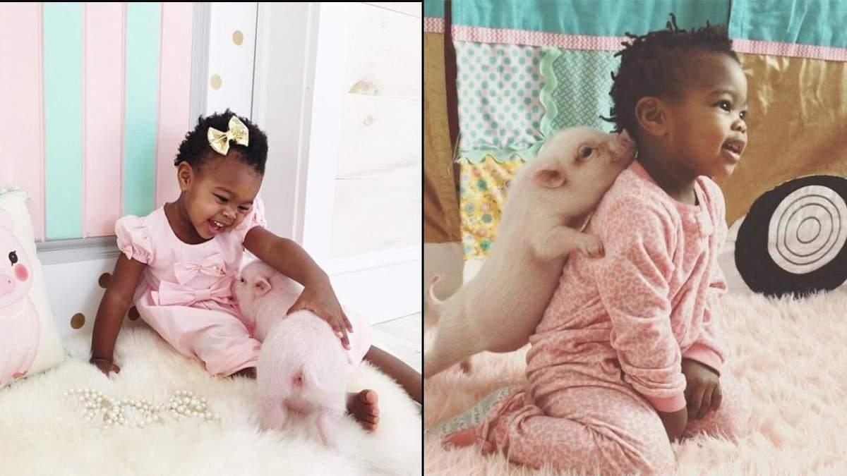 Дворічна дівчинка подружилася з маленьким поросятком: чарівні фото